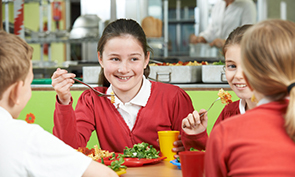 School Meals - school children enjoying a healthy school meal